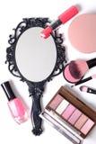 Black vintage hand mirror on white background. Black vintage hand mirror with cosmetics makeup on white background Stock Image