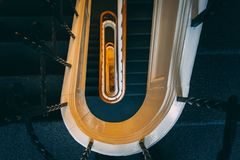 Black vintage oval spiral staircase. Stairs abstract. Top view stock image