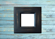 Black Vintage picture frame on blue wood Stock Photography