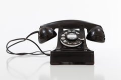 Black, vintage rotary phone on  white Royalty Free Stock Photo