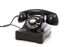 A black retro rotary phone on a white background Royalty Free Stock Image