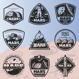Black Vintage Space Discovery Labels Set. With inscriptions and cosmic research elements on Mars planet background  vector illustration Stock Photos
