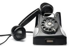 Black vintage telephone. Old antique black rotary phone royalty free stock image