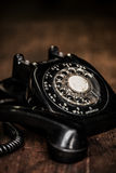 Black vintage telephone on a farm table Stock Images