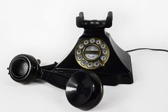 Retro Black Telephone with its earpiece lifted - Isolated royalty free stock photography