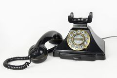 Retro Black Telephone with its earpiece lifted - Isolated royalty free stock photos