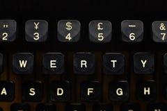 Black vintage typewriter close up on keys. Stock Photos