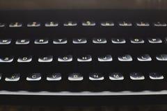 Black vintage typewriter close up on keys. Detail of a black vintage typewriter close up on keys Stock Image