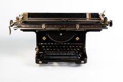 Black vintage typewriter. Vintage typewriter on white background royalty free stock photos