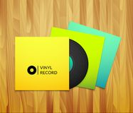 Black vintage vinyl record with blank yellow blue Stock Photos