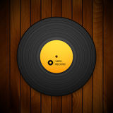 Black vintage vinyl record  on red wood Stock Photography