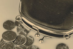 Black vintage wallet and coins isolated on white Stock Image