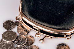 Black vintage wallet and coins isolated on white Royalty Free Stock Image