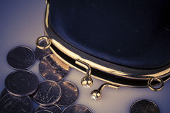 Black vintage wallet and coins  on white Royalty Free Stock Images
