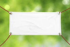 Black vinyl banner. Blank white vinyl banner hanging with rope stock photos