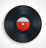 Black vinyl record disc with blank label in red Stock Photos