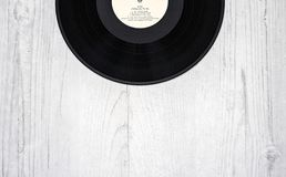 Black Vinyl Record on Wooden Surface stock photography