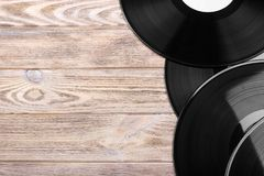 Black vinyl records on the wooden table, selective focus with copy space. Top view Royalty Free Stock Photo