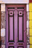 black violet wood old door in the centre of la boca Stock Images