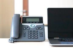 Black voip telephone on desk royalty free stock photo