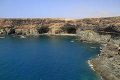 Black volcanic caves on the coast near Ajuy village, Fuerteventu Stock Photos