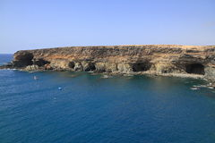 Black volcanic caves on the coast near Ajuy village, Fuerteventu Royalty Free Stock Photo