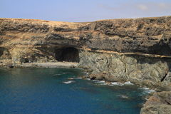 Black volcanic caves on the coast near Ajuy village, Fuerteventu Stock Images