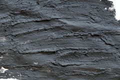 Black volcanic cosmetic clay texture close up. solution of cosmetic clay abstract background Royalty Free Stock Photos
