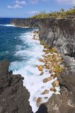 Black volcanic lava sea coast at Reunion island, France. Royalty Free Stock Photos