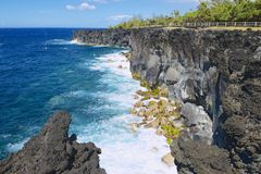 Black volcanic lava sea coast at Reunion island, France. Stock Images