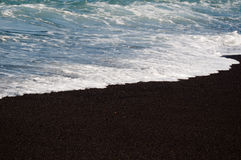 Black volcanic sand beach Royalty Free Stock Photography