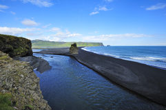 Black volcanic sand beach at Dyrholaey, Iceland Stock Images