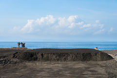 Black volcanic sand on sea salt production farm in Bali, Indones Stock Photography