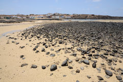 Black volcanic stones on the beach, Fuerteventura Royalty Free Stock Photo