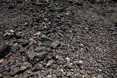 Black volcanic stones soil texture Royalty Free Stock Photo