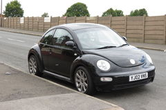 Black Volkswagen New Beetle car Royalty Free Stock Image