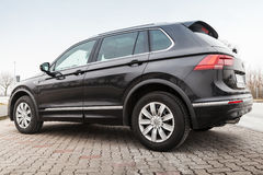 Black Volkswagen Tiguan, 4x4 R-Line. Hamburg, Germany - February 10, 2017: Outdoor photo of second generation Volkswagen Tiguan, 4x4 R-Line. Black compact Royalty Free Stock Photos