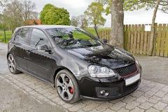 Black Volkswagen VW Golf GTI sports car in Germany