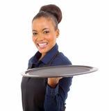 Black waitress tray. Portrait of black waitress with tray over white background stock image