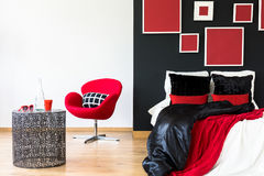 Black wall in a bedroom. Black wall with artworks in a modern bedroom Stock Photos