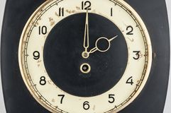 Black wall clock on white background.The time is going on concept. Place for text. Copy space. Retro clock isolated on over white background stock image