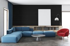Black wall living room, blue sofa, poster. Black wall living room interior with a blue sofa, a red armchair, bookshelves and a framed vertical poster. 3d Royalty Free Stock Photo