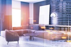 Black wall living room corner, blue sofa, poster. Concrete wall living room corner with a gray sofa, an armchair, bookshelves and two framed vertical posters. 3d Stock Photos