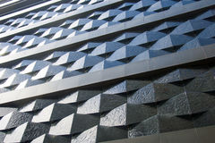 Black wall of a relief building in the city. Black wall of a relief building in the city Stock Photos