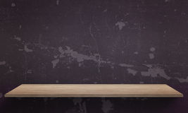 Black wall texture in background. Wooden table with free space Royalty Free Stock Photo