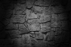 Black wall with textured stone blocks Stock Image