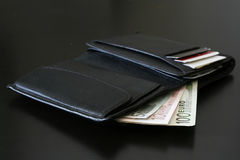 Black wallet. Euro bills coming out of wallet Stock Images