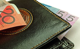 Black wallet and bank notes Stock Photos