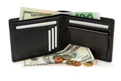 Black wallet, banknotes and coins isolated Royalty Free Stock Photo