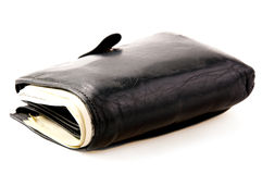 Black wallet with banknotes on light background. Many banknotes in black wallet on light background Stock Photo